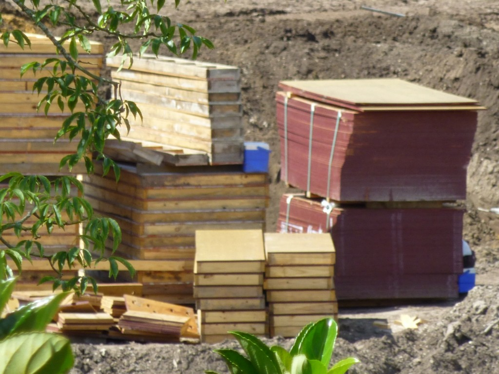 Piles of wood, with what appears to be someone's lunchboxes?