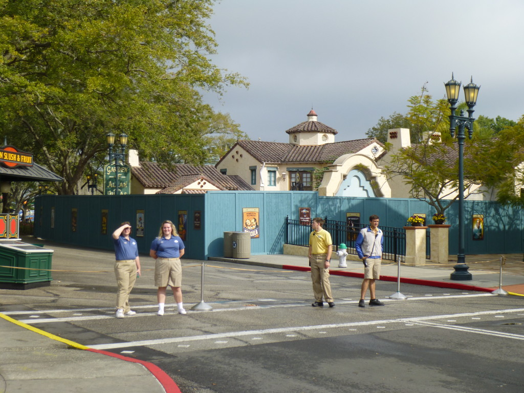 Cast members redirecting traffic down toward the lagoon as walkway was closed off