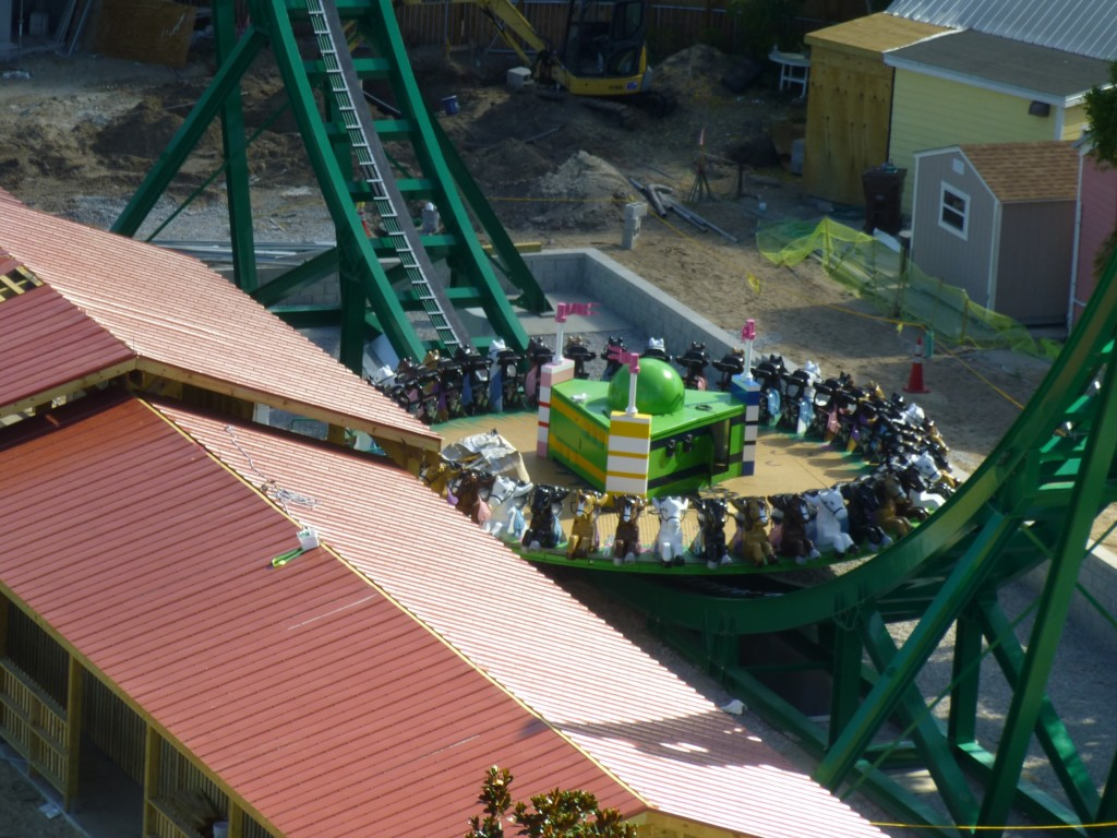 Close up view of Mia's Riding Adventure, the new disc coaster, with its horse-shaped seats
