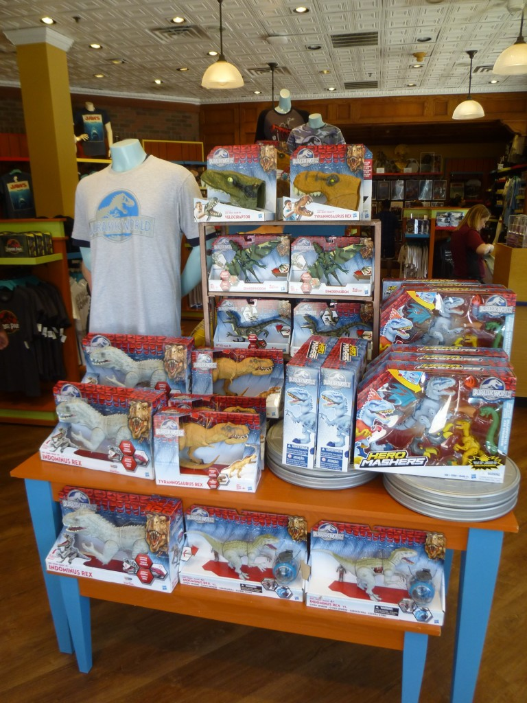 Jurassic World Hasbro toys and the adult logo shirt at the entrance