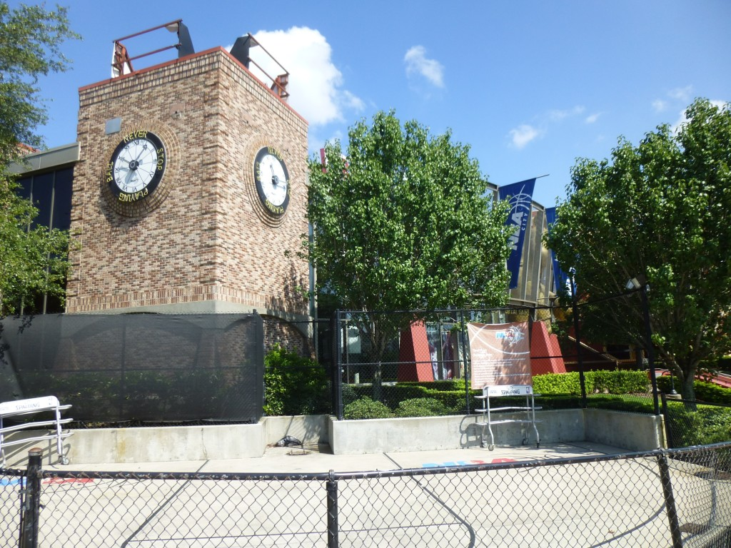 """One of the more active areas, the 3-pont challenge, now quiet. Ironically a clock behind says """"Never stop playing."""""""