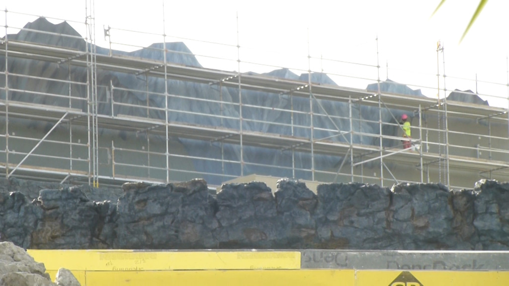 Work continues on background mural facade