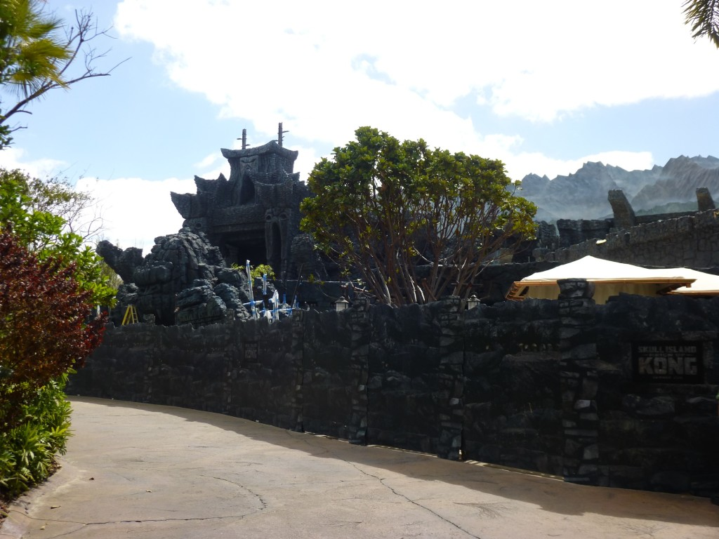 View from Jurassic Park side, gift shop stand and ride exit on the right