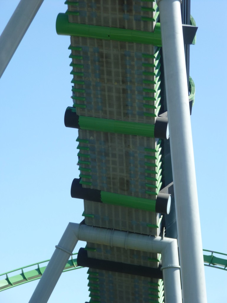 The green poles under launch tunnel being painted black as well