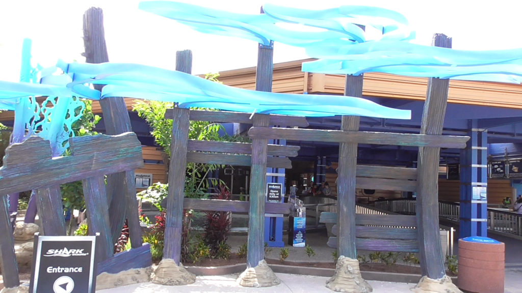 Theming in front of shark feeding tank and restaurant entrance