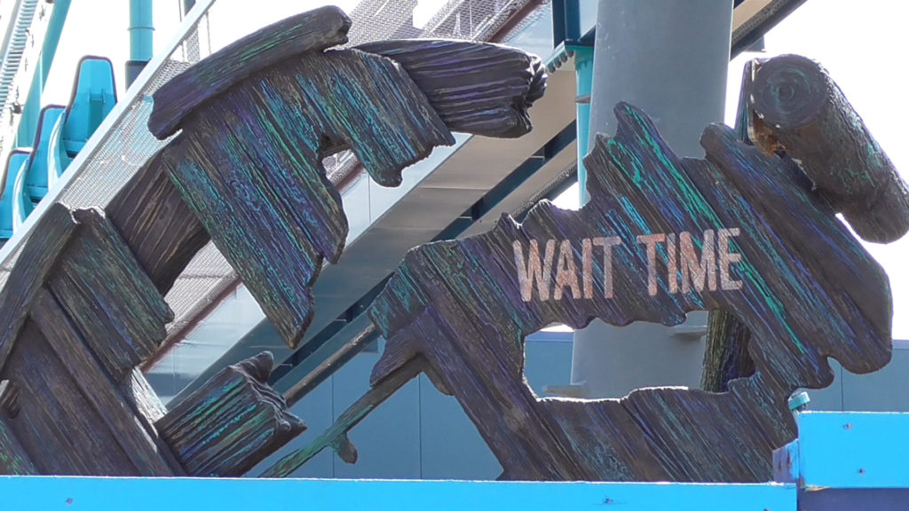 Wait time sign beautifully weathered to look underwater rotted