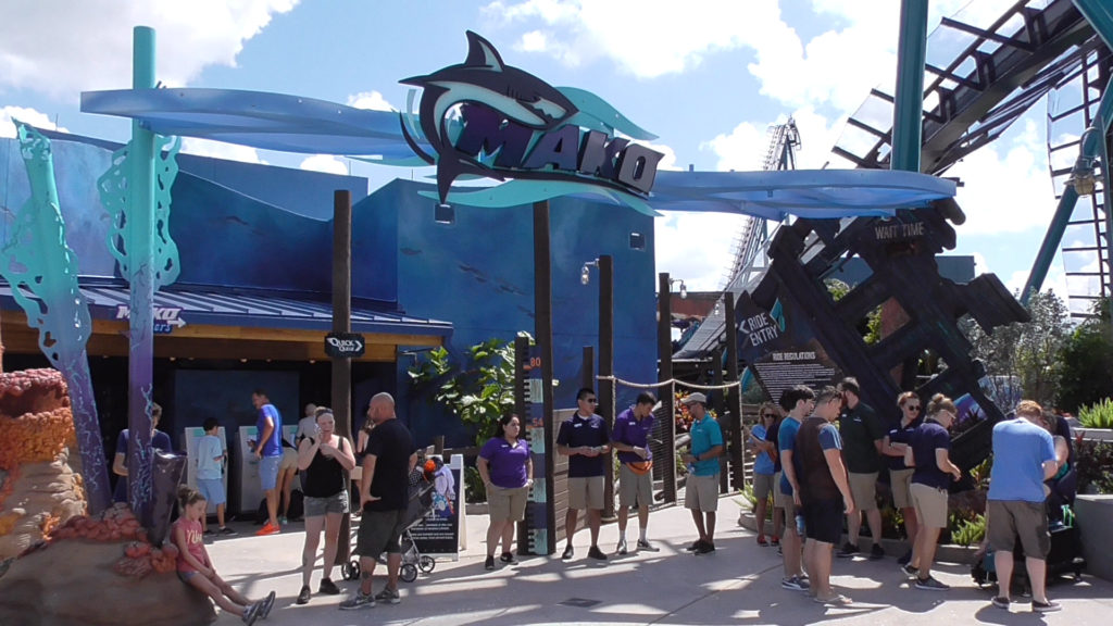 The Mako ride entrance, surrounded by staff handing out Soft Open tickets