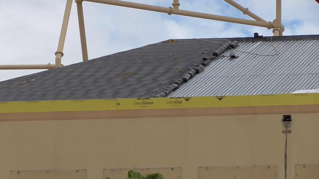 Roof being weatherproofed