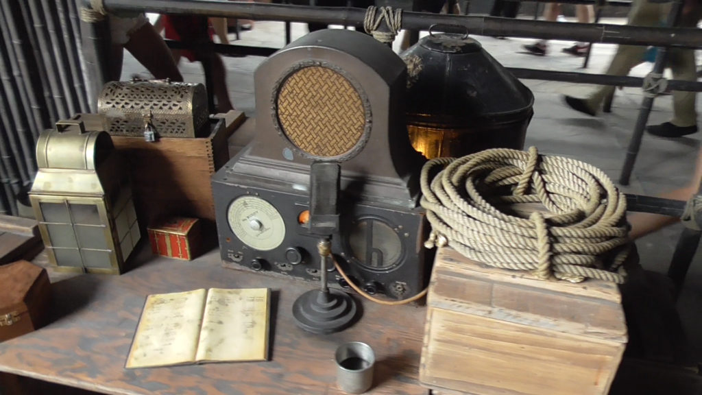 Old-fashioned radio on a desk, spouting news reports and old music