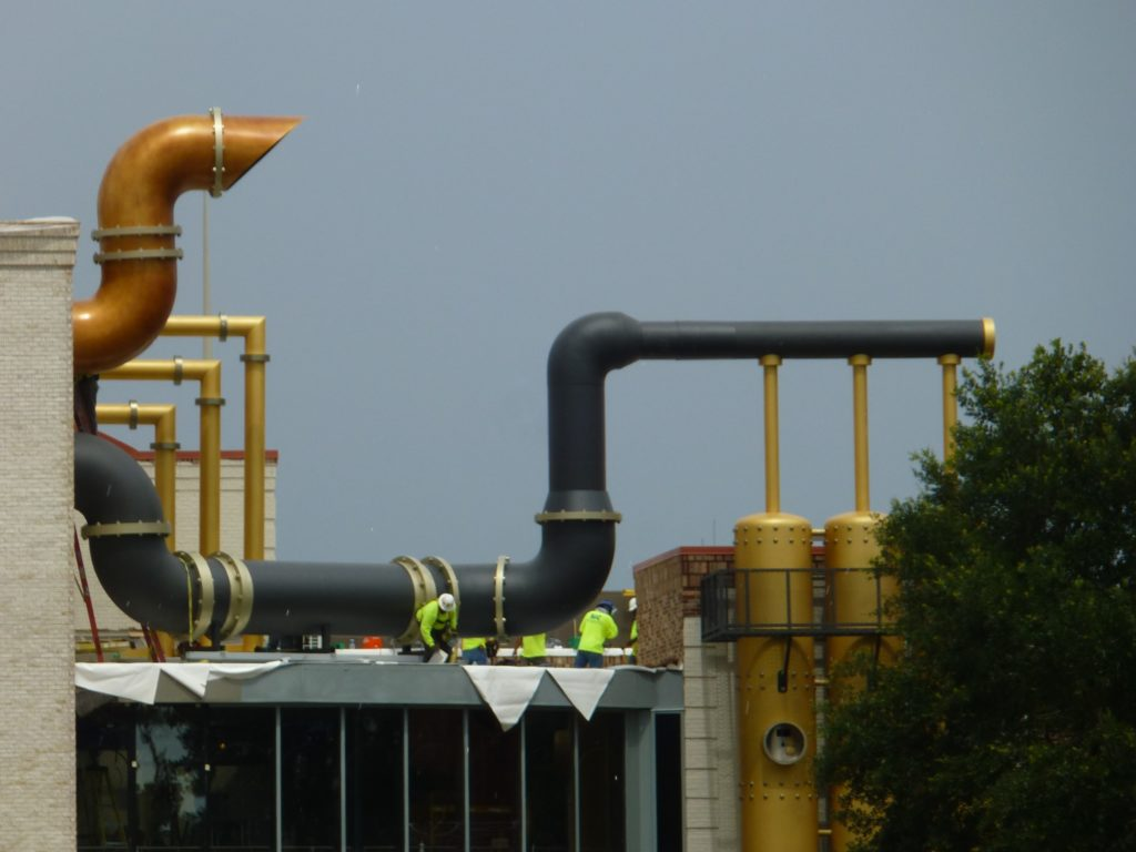 Workers adding new touches to pipes