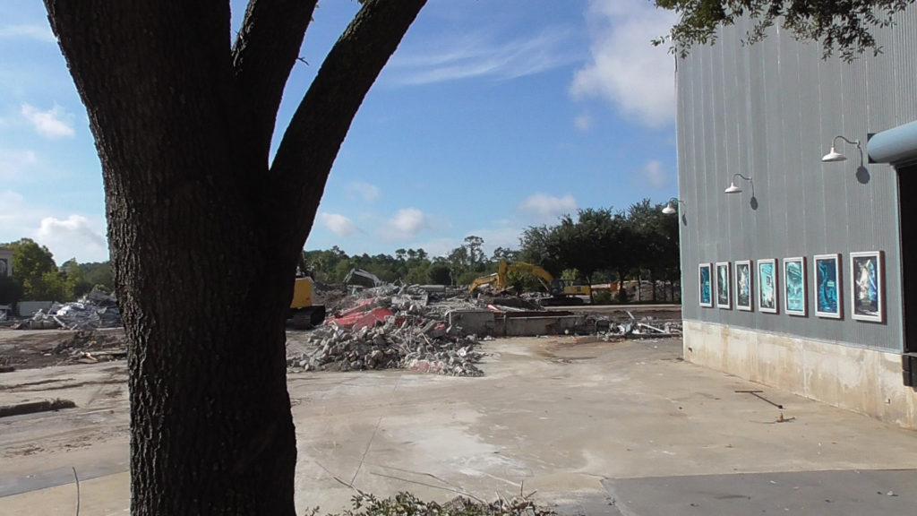 Piles of debris sit where Backlot Tour Entrance once stood
