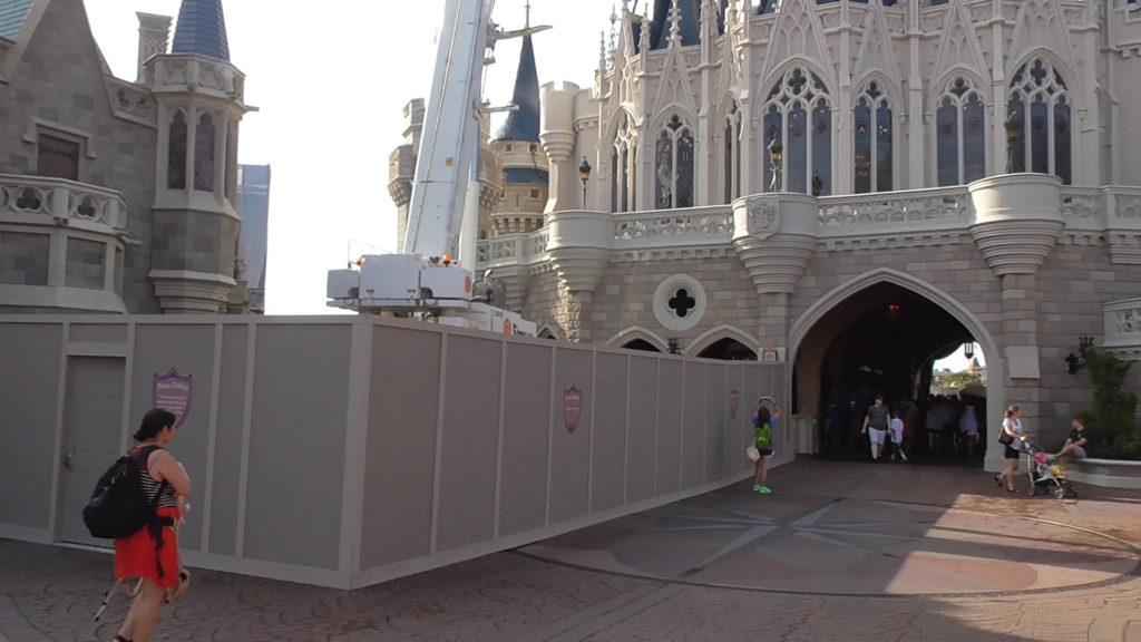 Work walls and crane behind Cinderella Castle