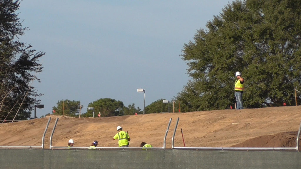 Workers on new berm