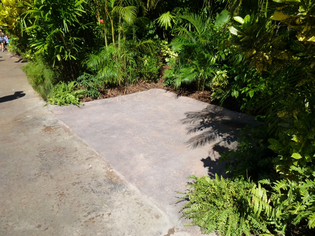 Concrete has been filled in where the Jurassic Park arch was, so no more potted plants.