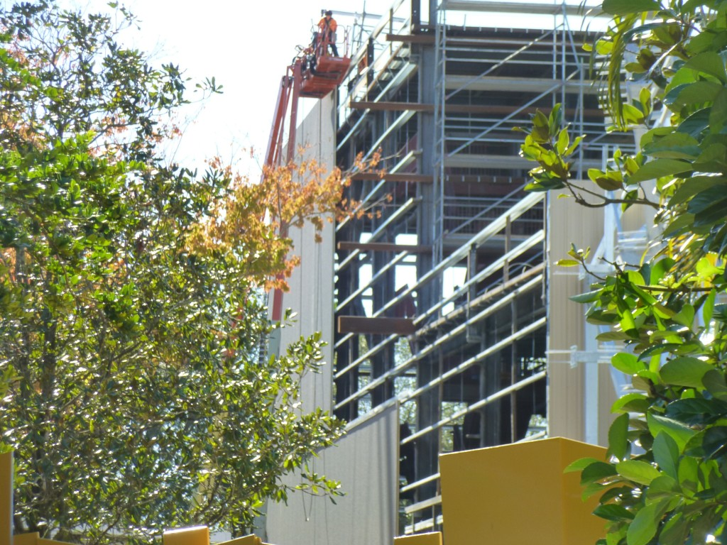 Wall siding going up on the sides of the building to match the front.