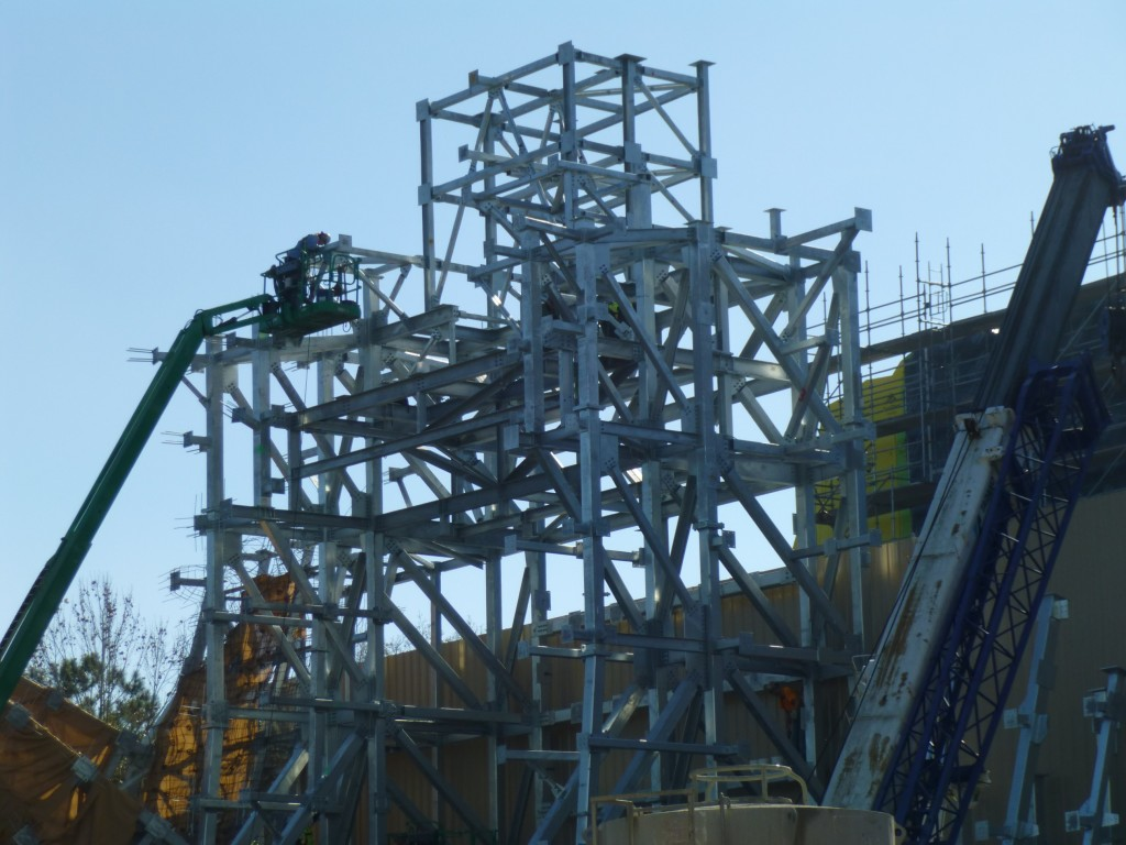 Workers building the gate structure