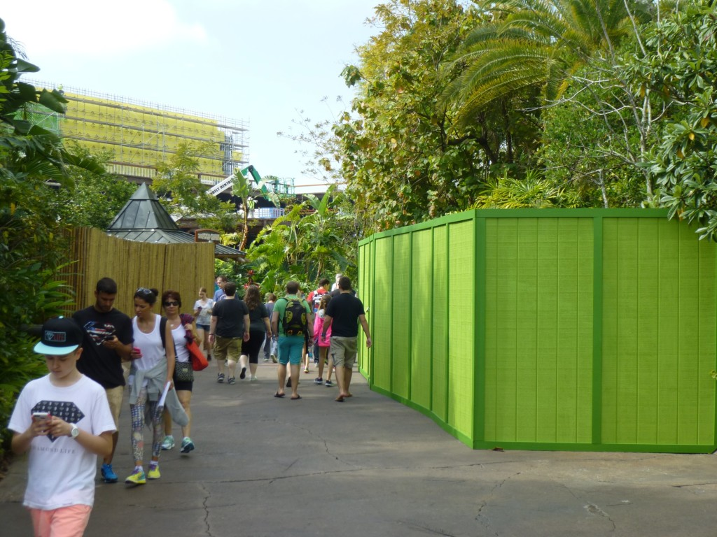 The walkway is extra narrow with a new bright green wall that has sprung up, most likely related to Jurassic Park area refurbishments