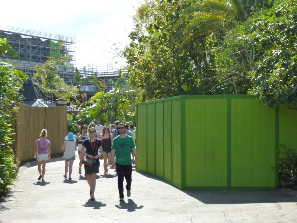 Mysterious green construction walls that have appeared across the pathway, bordering Camp Jurassic side