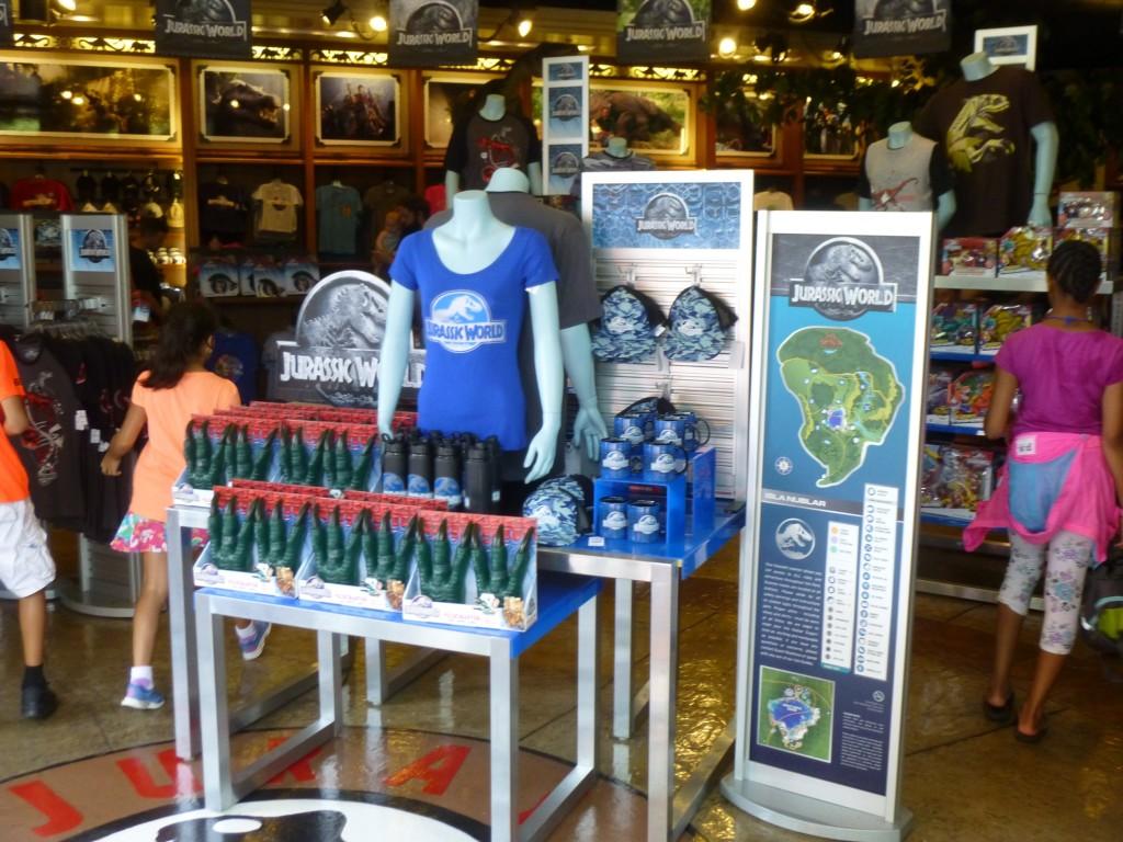 Jurassic World merchandise surrounded by new logo signage