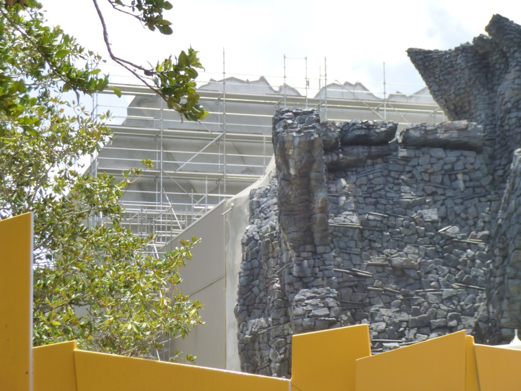 Sculpted concrete connection between facade and building walls added, filling the gap