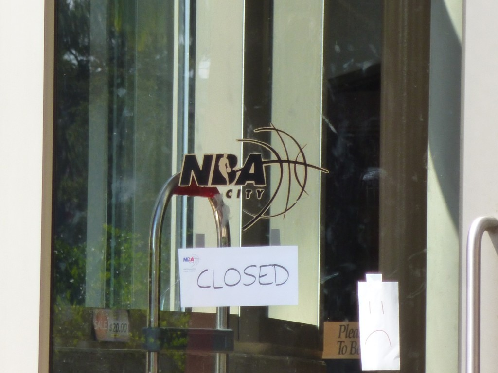 "NBA City's doors adorned with a plain piece of paper simply stating ""Closed"" and another paper with a sad face"