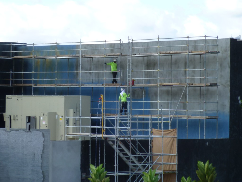 Workers painting