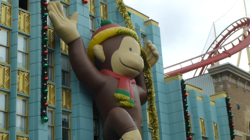 Curious George swinging around New York