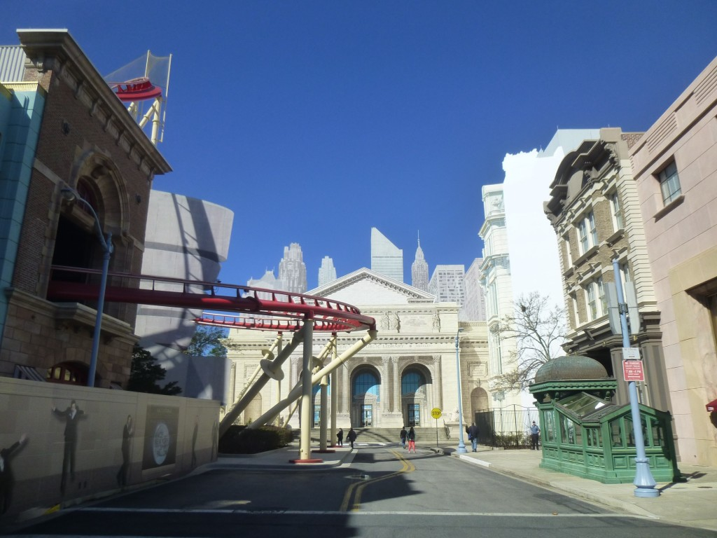 View down the street with old Ghostbusters firehouse facade on the left. Right cutout building being refurbished