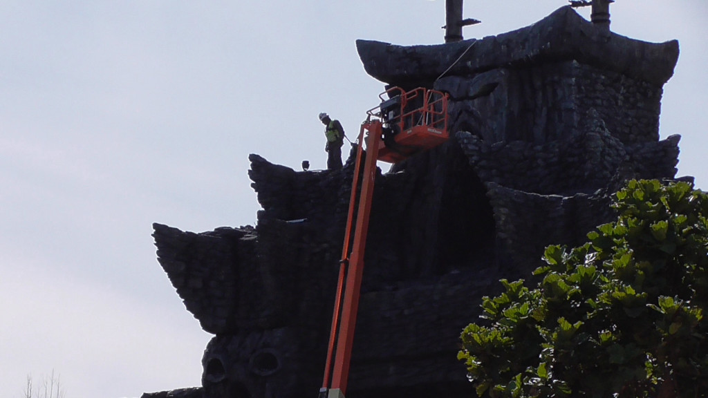Tethered to a rope atop the temple