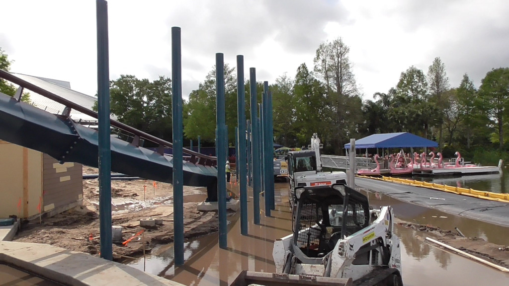 Wall being built around track over lagoon