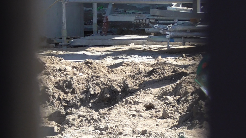 All the concrete has been tore up around the queue