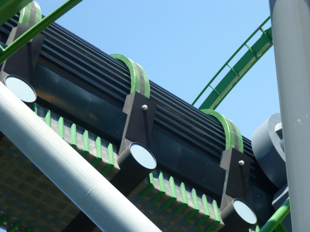 Black stripes being added on green trim around launch tunnel