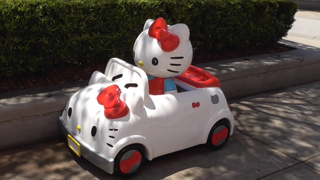 There's room in the backseat to get your picture taken riding with Hello Kitty