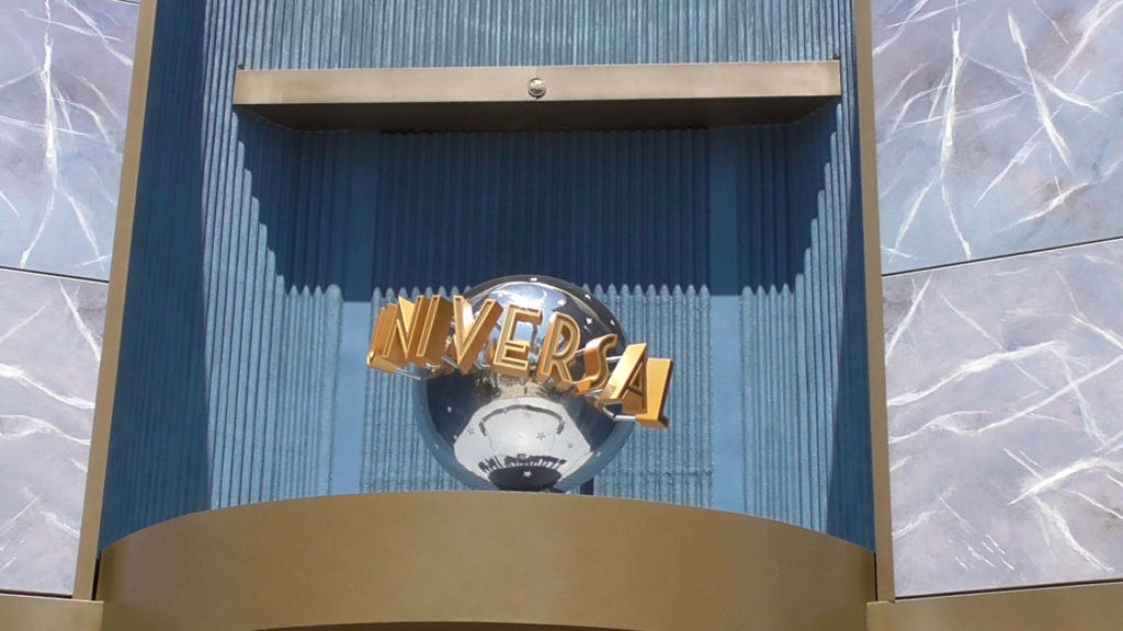 New Universal globe added above entry to neighboring shop