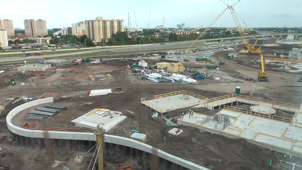Side of the construction zone, with I-4 in the background and berm separating the park from Cabana Bay at the bottom of the image