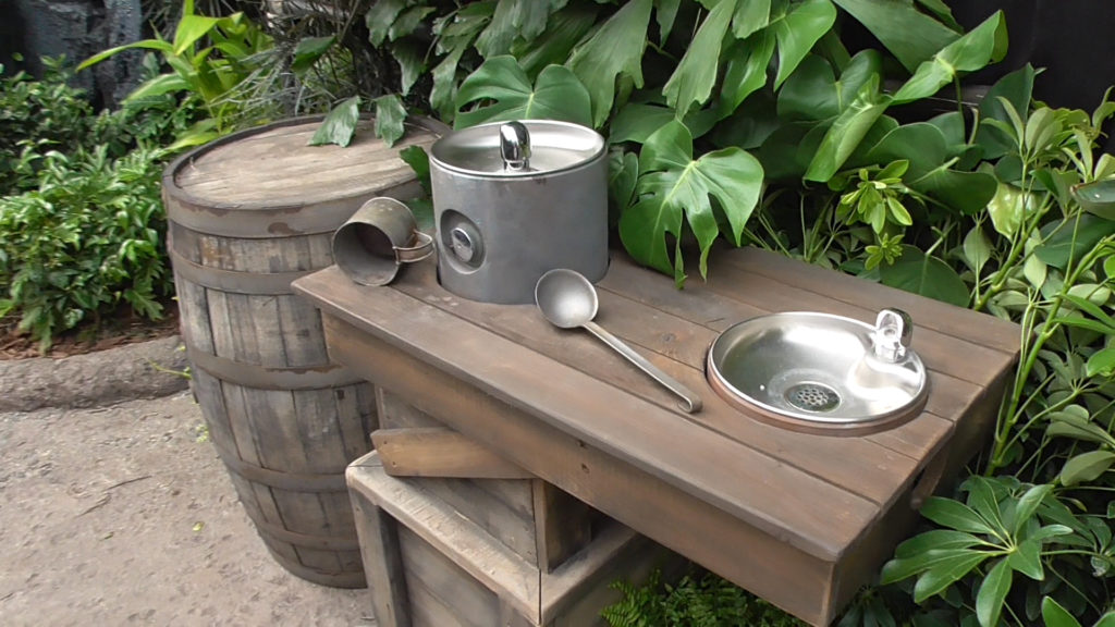 Themed water fountains in the queue