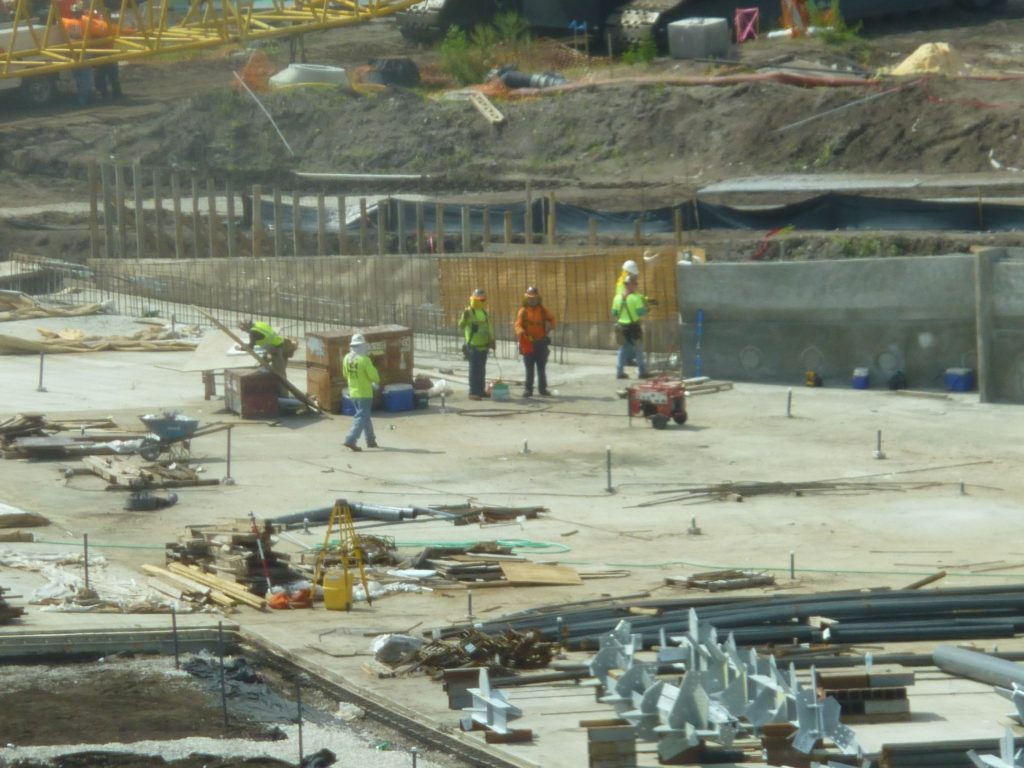 Workers inside wave pool area