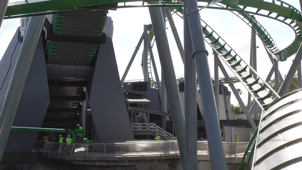 Workers working on the ride exit area