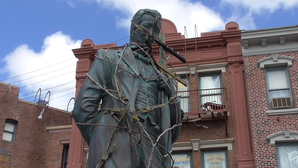 Lew Wasserman statue covered in vines in New York for Horror Nights
