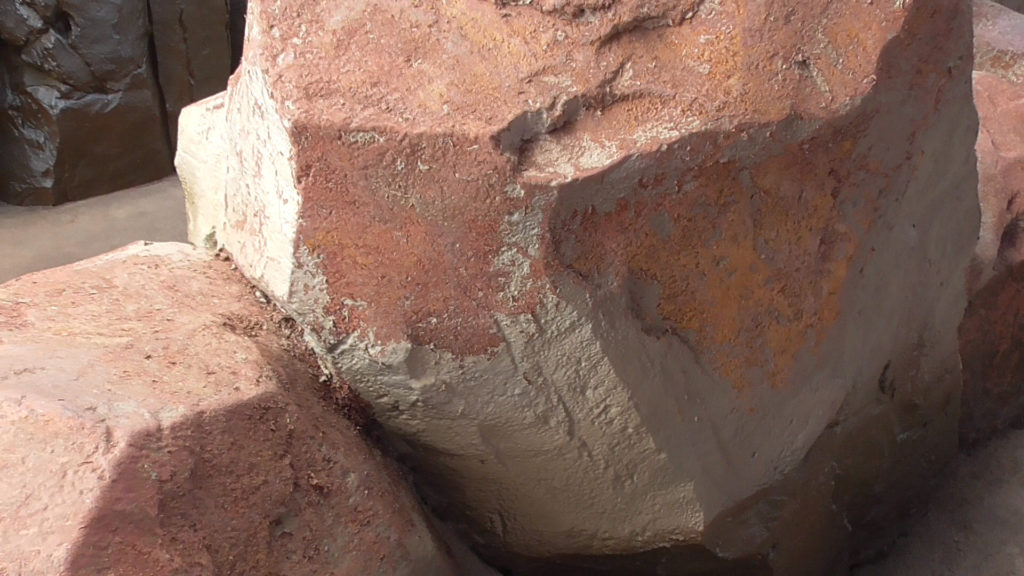 Rocks that are facing guest pathways have had much of their paint worn off over the years